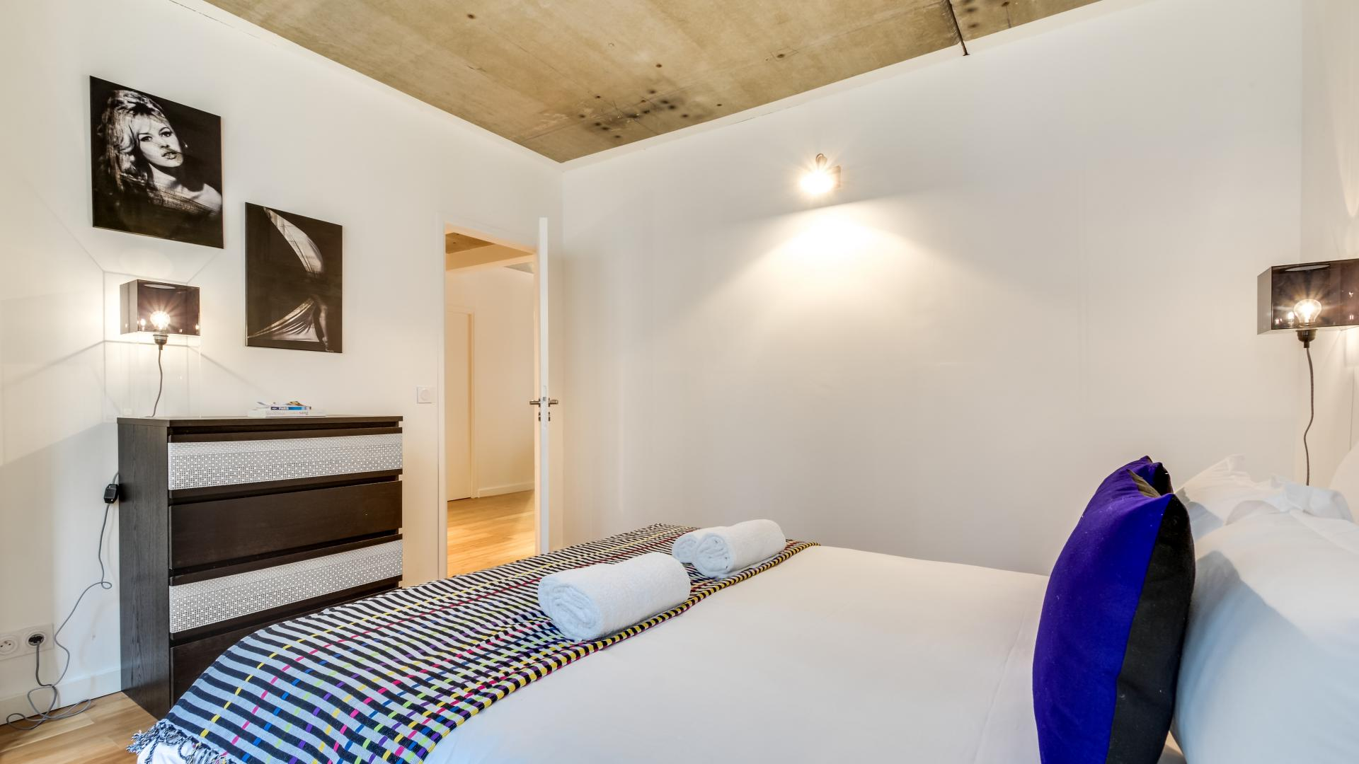 Bed at  Rue de Milan Apartments - Citybase Apartments