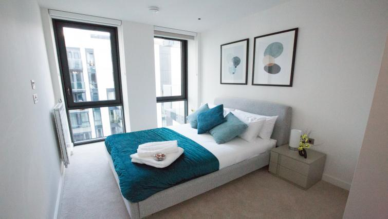 Blue bedroom at GIGLI Apartments Wembley - Citybase Apartments