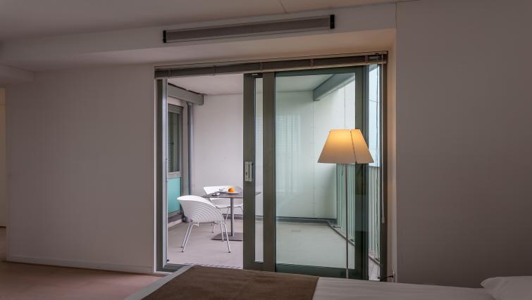 Bed at La Fenêtre Apartments - Citybase Apartments