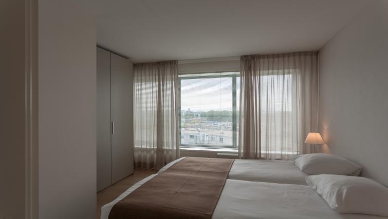 Double bed at La Fenêtre Apartments - Citybase Apartments
