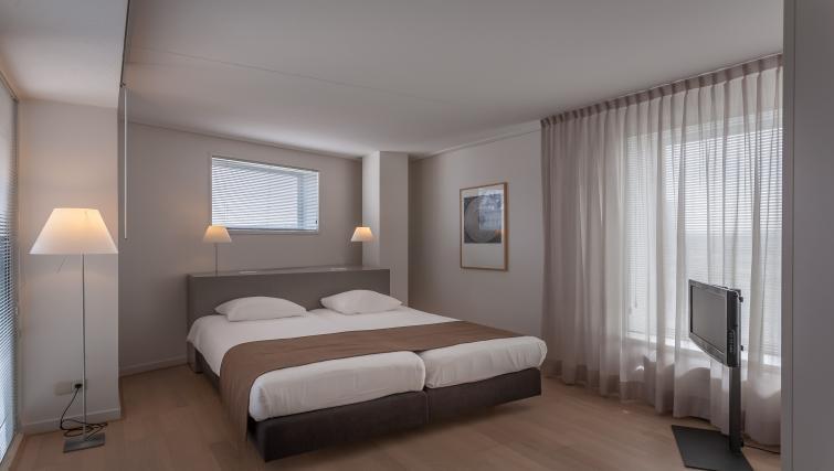 Bedroom at La Fenêtre Apartments - Citybase Apartments
