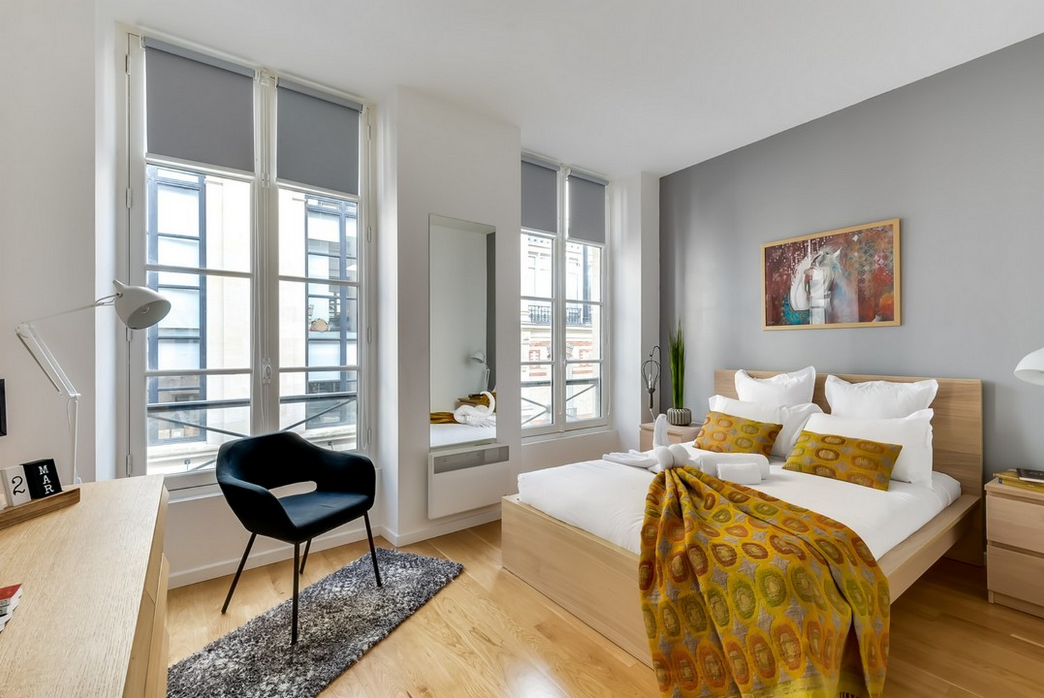 Sleek bedroom at Enghien Apartments - Citybase Apartments