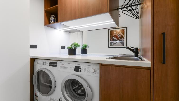 Laundry room at the County Down Apartment - Citybase Apartments