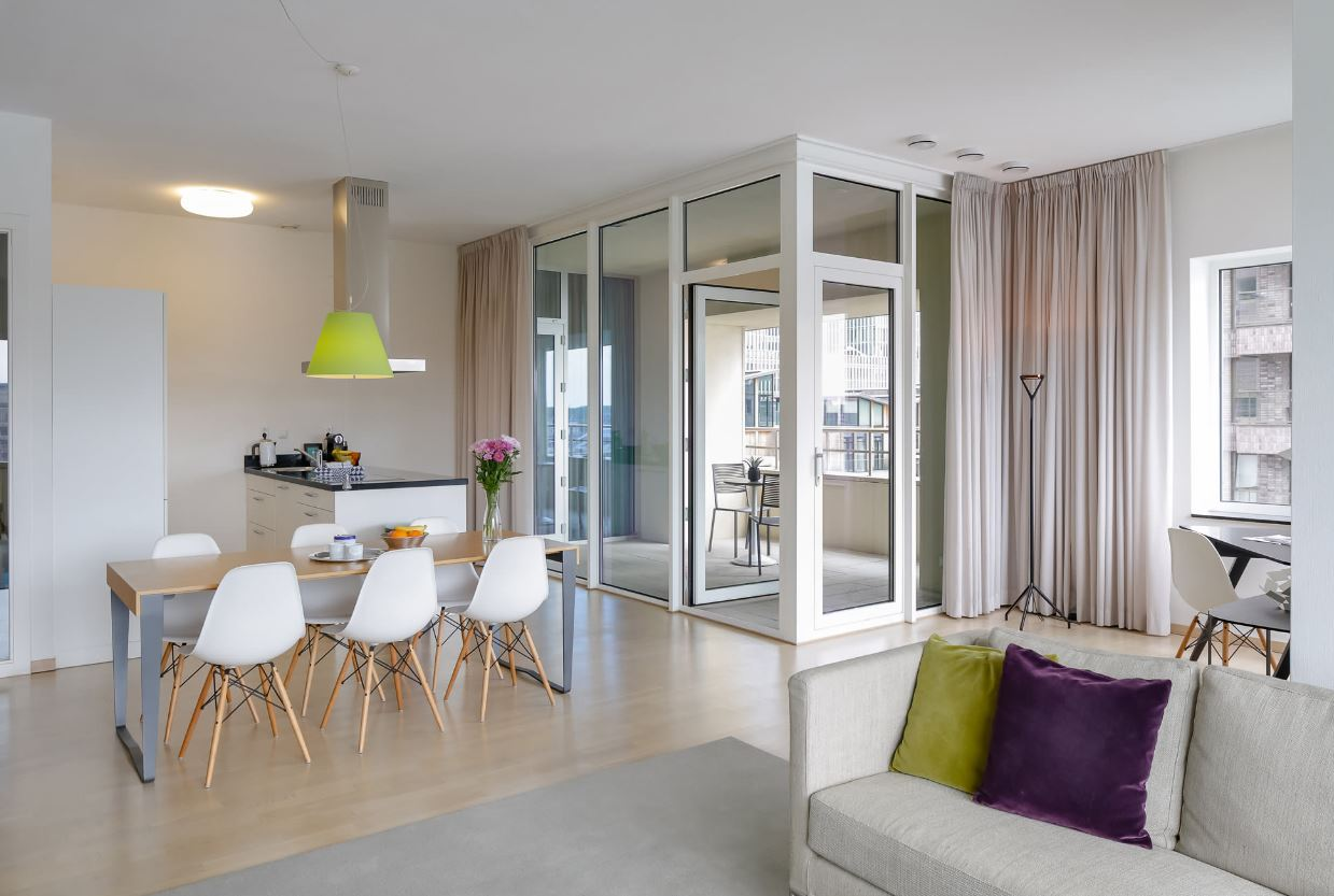 Living/dining area at New Orleans Apartments, Kop Van Zuid, Rotterdam - Citybase Apartments