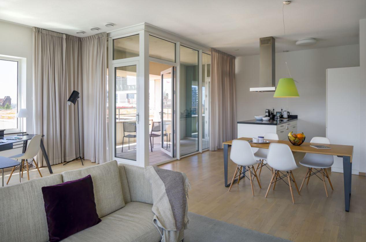 Living and dining area at New Orleans Apartments, Kop Van Zuid, Rotterdam - Citybase Apartments