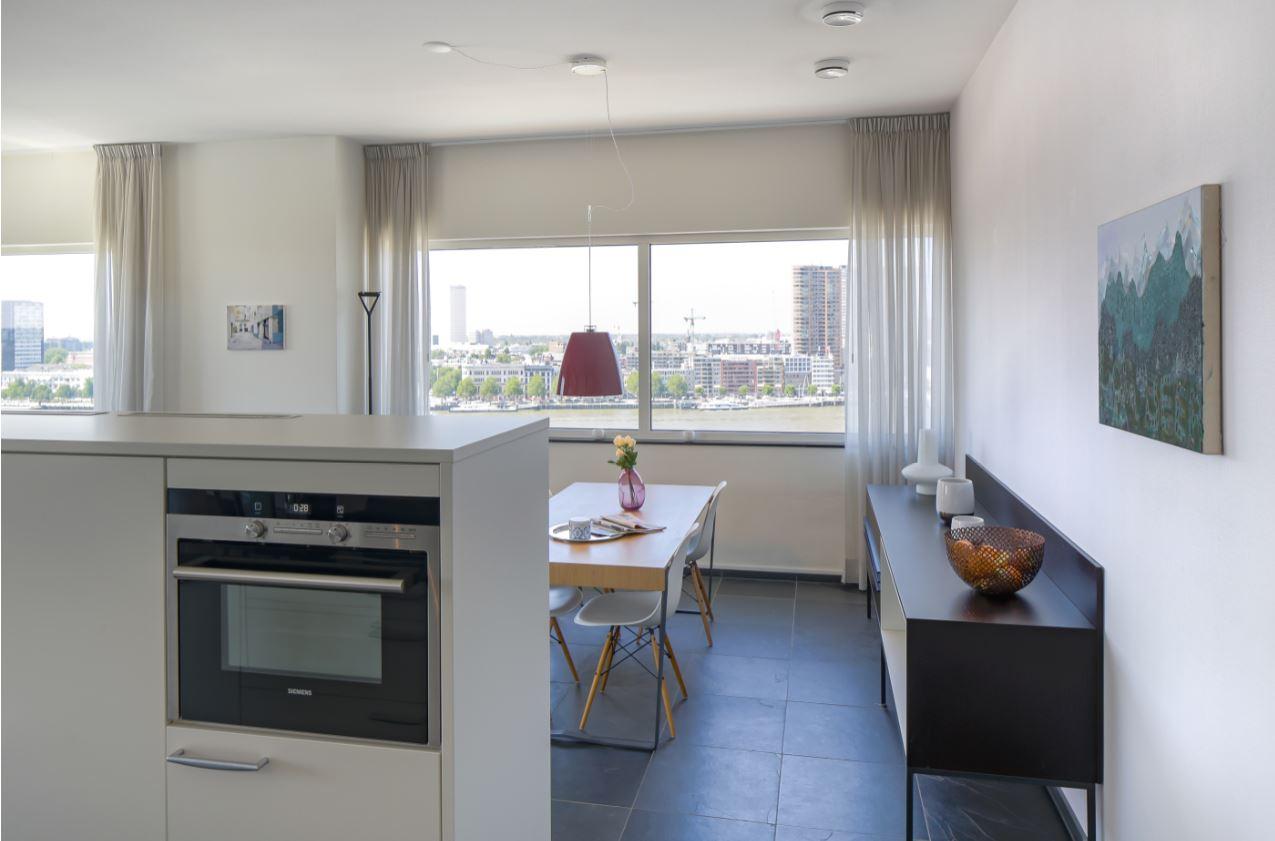 Open-plan living area New Orleans Apartments, Kop Van Zuid, Rotterdam - Citybase Apartments