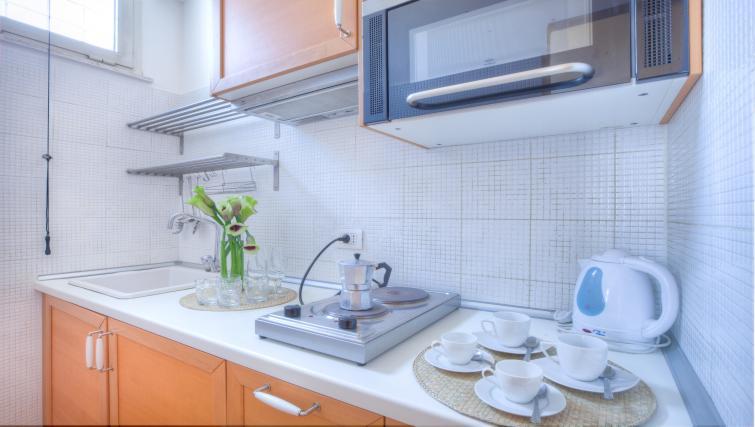 Kitchen facilities at Penna Apartment - Citybase Apartments
