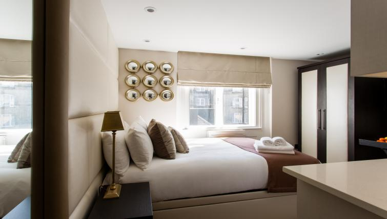 Cosy bedroom at the Flying Butler Baker Street Apartments - Citybase Apartments