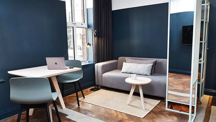 Table/Desk & Sofa at The Flint Studios - Citybase Apartments