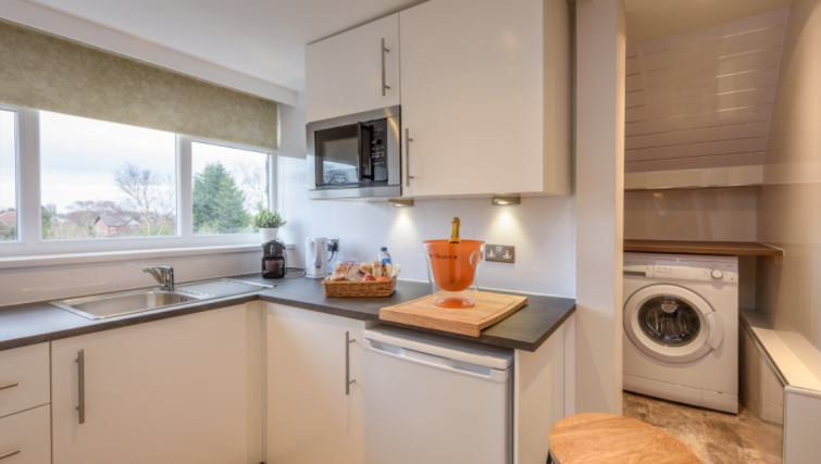 Equipped kitchen at Lennox Lea Studios & Apartments - Citybase Apartments