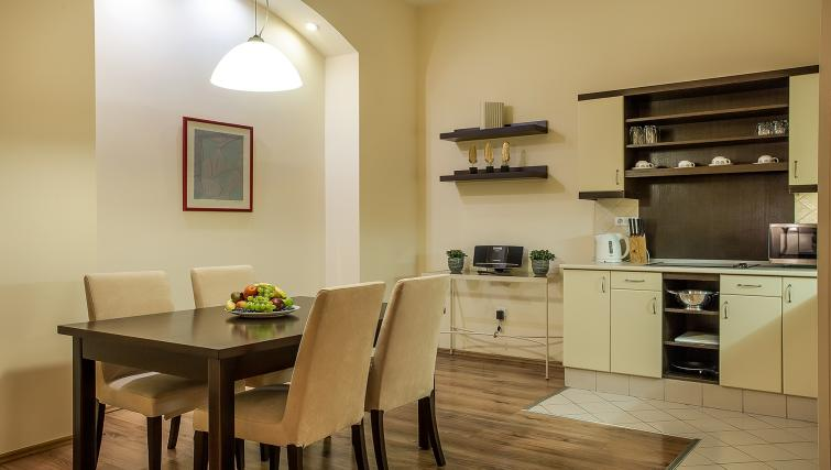 Dining area at the Mamaison Residence Izabella - Citybase Apartments