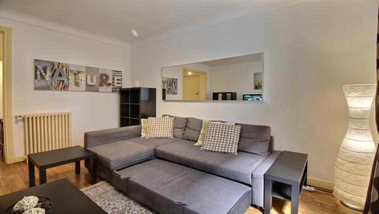 Sofa area at Gris Civry Apartment - Citybase Apartments