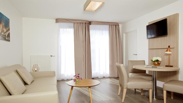 Living room at the Residhome Paris Asnières Park - Citybase Apartments