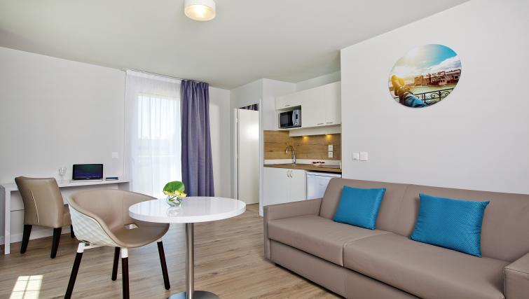 Living area at Jacqueline De Romilly Apartments - Citybase Apartments