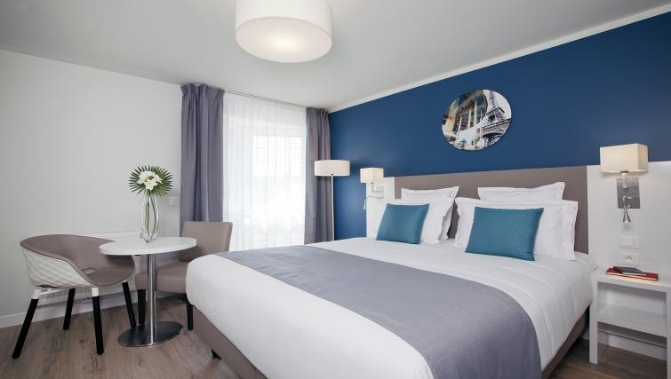Bedroom at Jacqueline De Romilly Apartments - Citybase Apartments