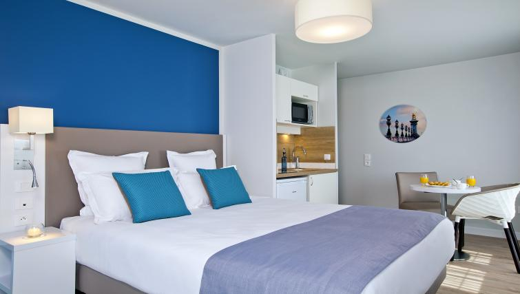 Double bed at Jacqueline De Romilly Apartments - Citybase Apartments