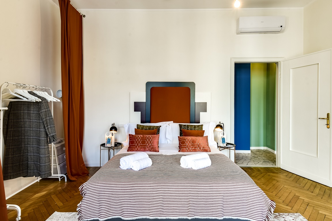 Double bed at  Ariberto Apartment - Citybase Apartments