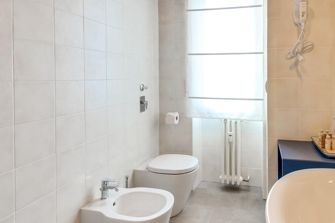 Bright bathroom at  Ariberto Apartment - Citybase Apartments