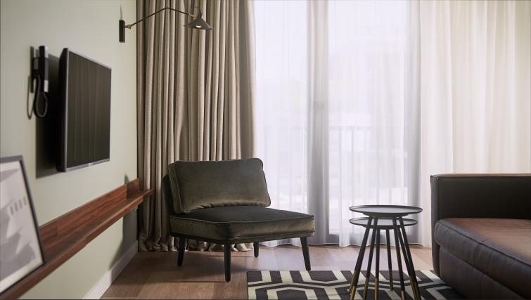 Living space at Corendon Village Hotel Amsterdam - Citybase Apartments