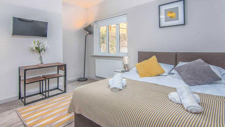 Modern bedroom at Priory Road Apartment - Citybase Apartments
