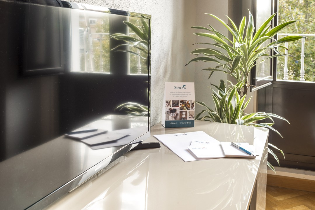 TV at Tirso de Molina Apartment - Citybase Apartments