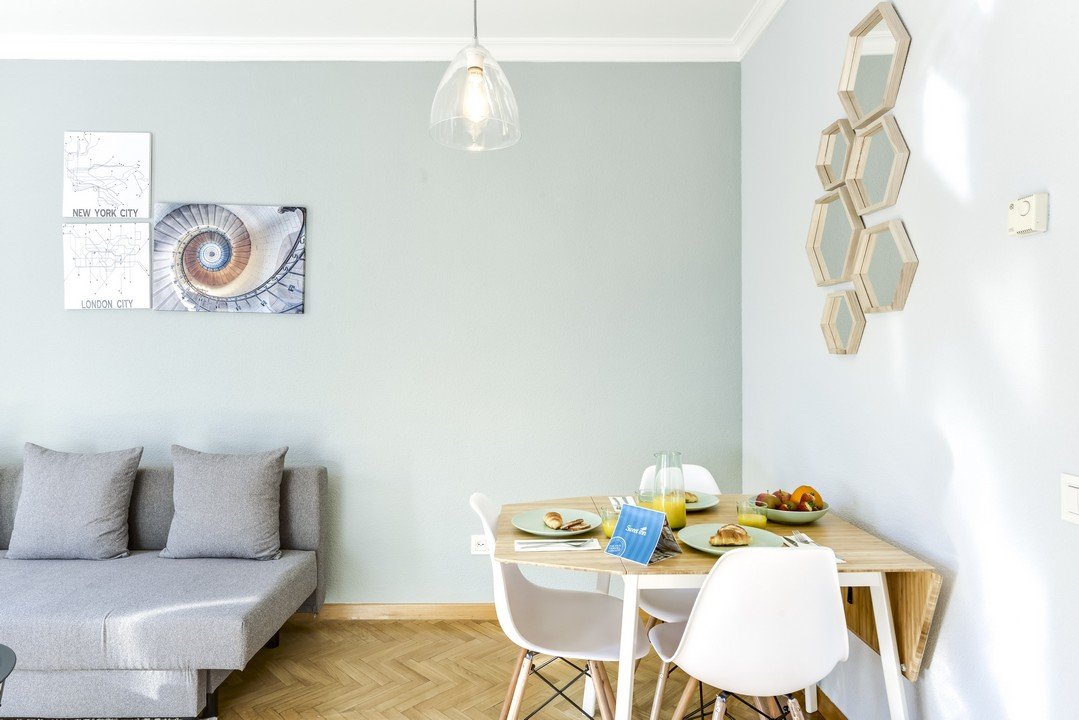 Dining area at Tirso de Molina Apartment - Citybase Apartments
