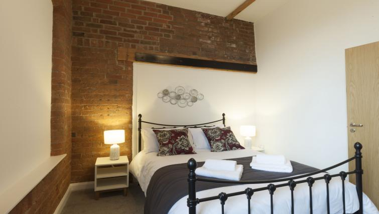 Large bed at the Raleigh Loft Apartment - Citybase Apartments