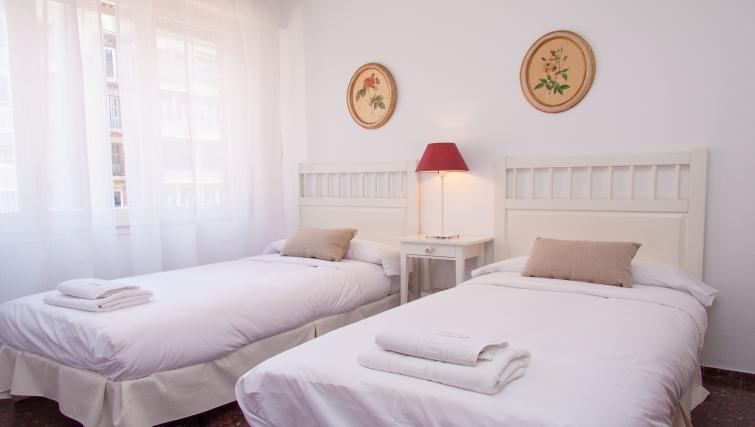 Bedroom at the Delicat Santalo Apartment - Citybase Apartments
