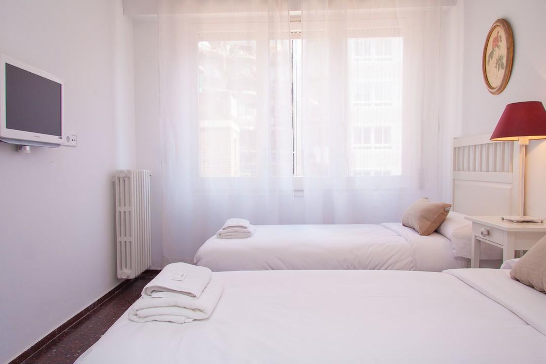 Bright bedroom at Delicat Santalo Apartment - Citybase Apartments