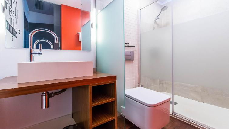Bathroom at the Loft Olimpia Beach Apartment - Citybase Apartments