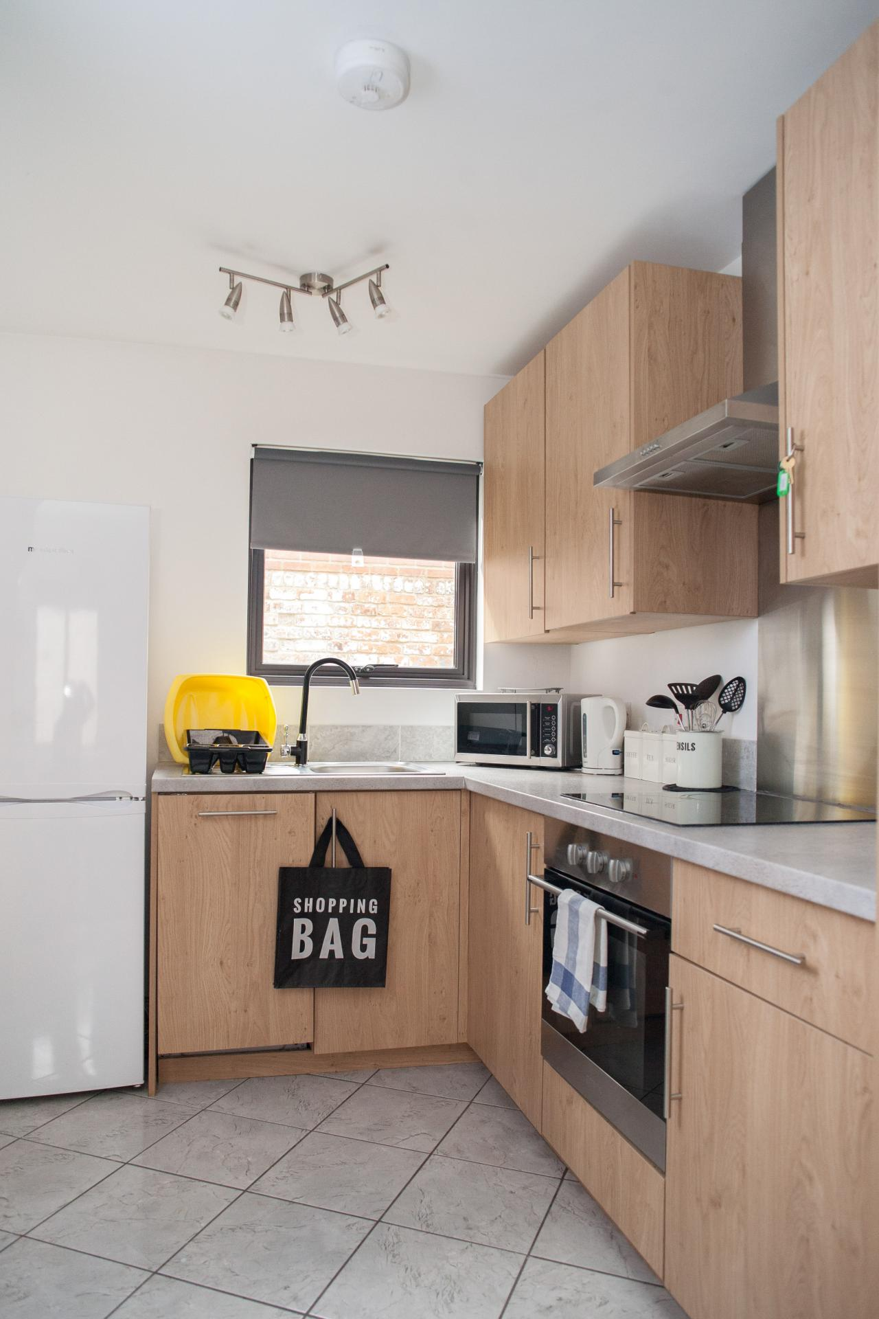 Modern kitchen at Quire Court Apartments, Centre, Gloucester - Citybase Apartments