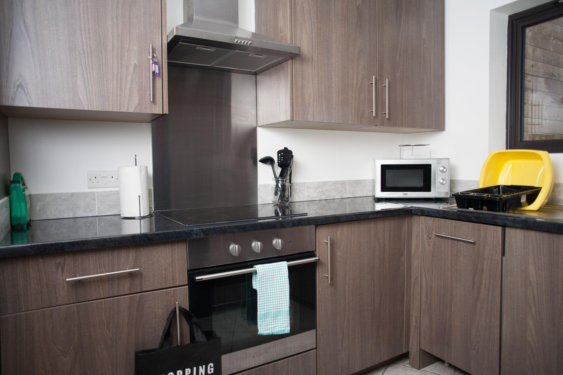 Wooden kitchen at Quire Court Apartments, Centre, Gloucester - Citybase Apartments