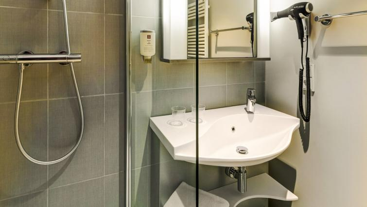Bathroom at Adagio Frankfurt City Messe Apartments - Citybase Apartments