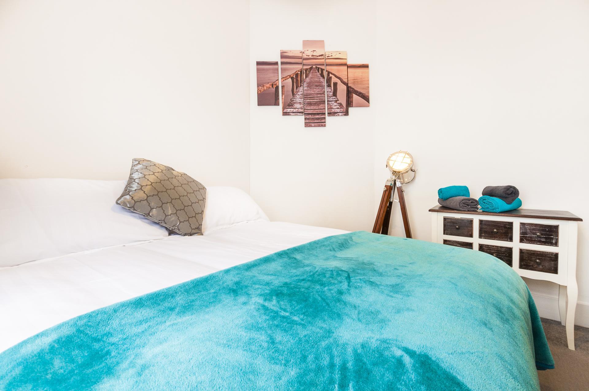 Cosy bedroom at Kimberley Road Apartment - Citybase Apartments