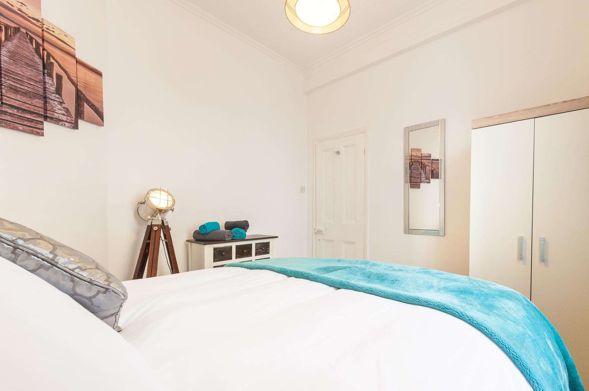 Bright bedroom at Kimberley Road Apartment - Citybase Apartments