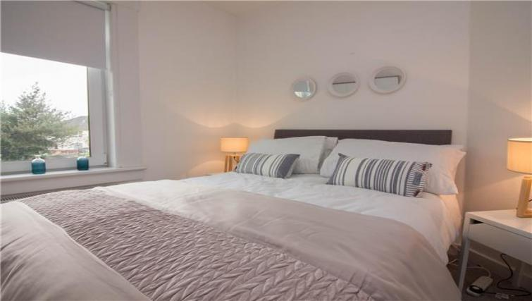 Bright bedroom at Elderpark View Apartment - Citybase Apartments