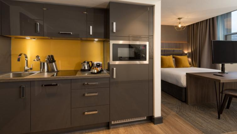 Kitchen at Roomzzz Manchester Corn Exchange - Citybase Apartments