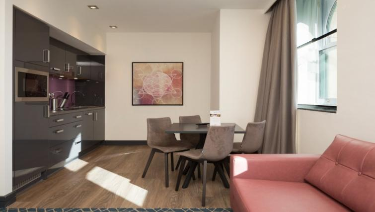 Living area at Roomzzz Manchester Corn Exchange - Citybase Apartments