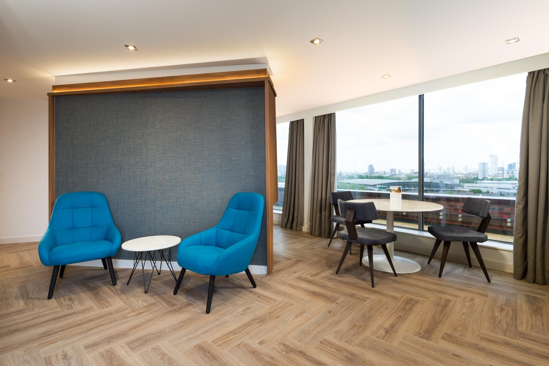 Seating area at Roomzzz London Stratford - Citybase Apartments