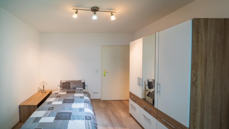 Bedroom at Rue du Soleil Apartment - Citybase Apartments