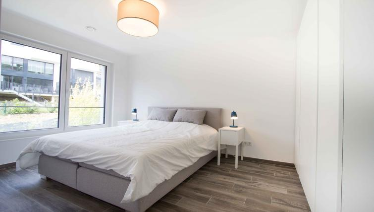 Bed at the Rue des Grottes Apartment - Citybase Apartments