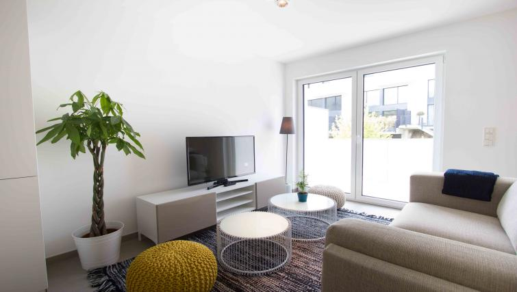 Lounge at the Rue des Grottes Apartment - Citybase Apartments