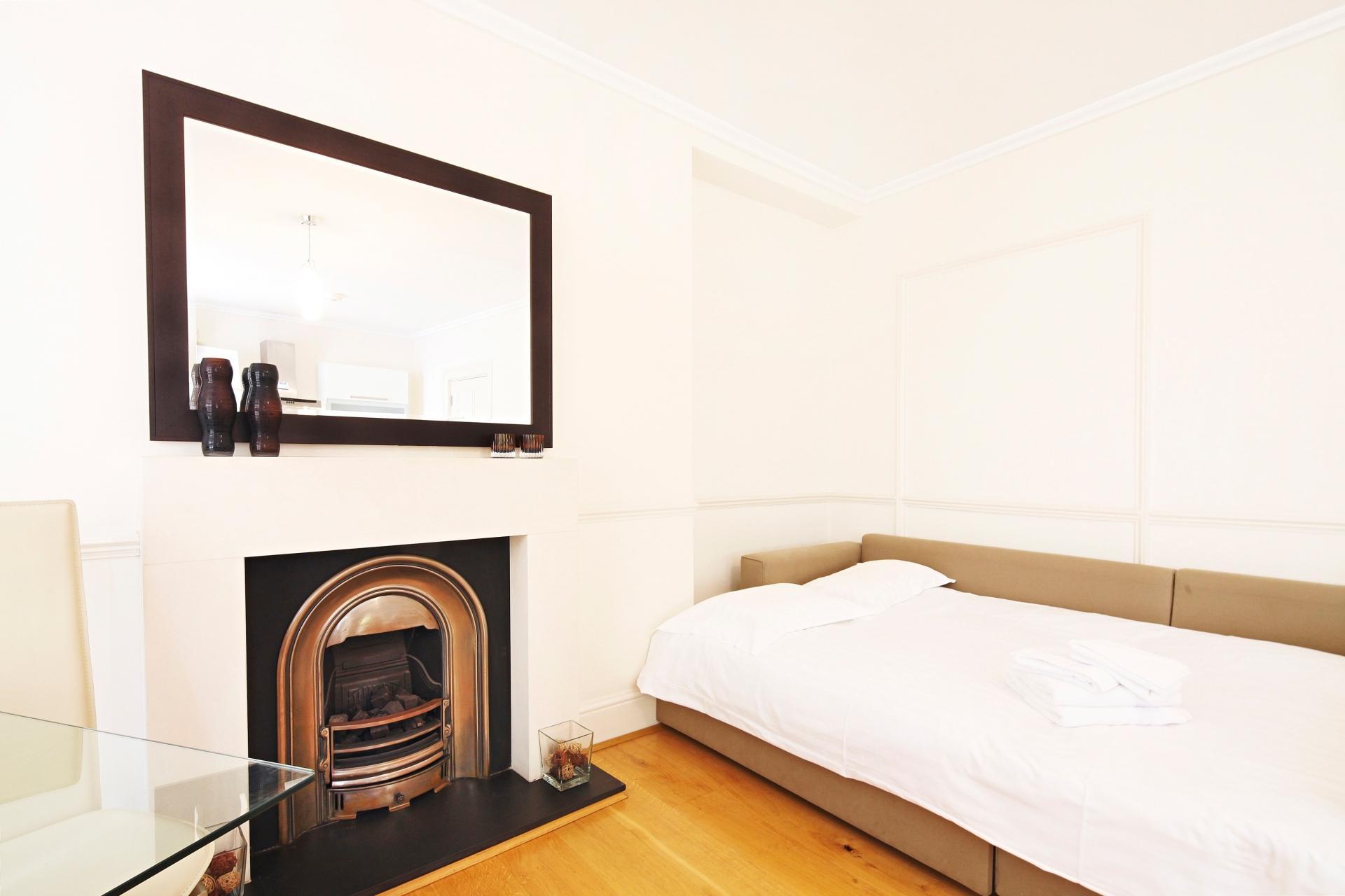Sofa bed at  LCS Hanover Place Apartments - Citybase Apartments