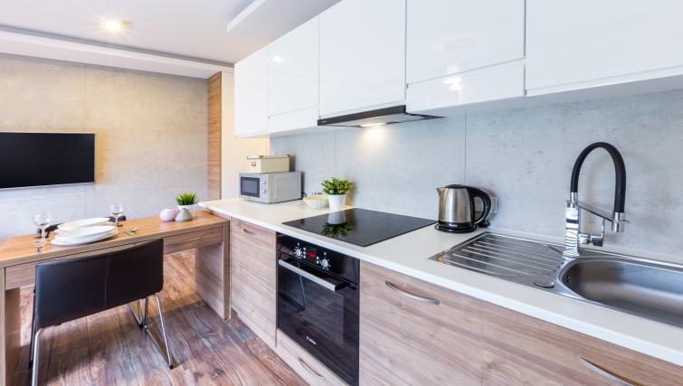 Modern kitchen facilitites at Ariańska Residence - Citybase Apartments