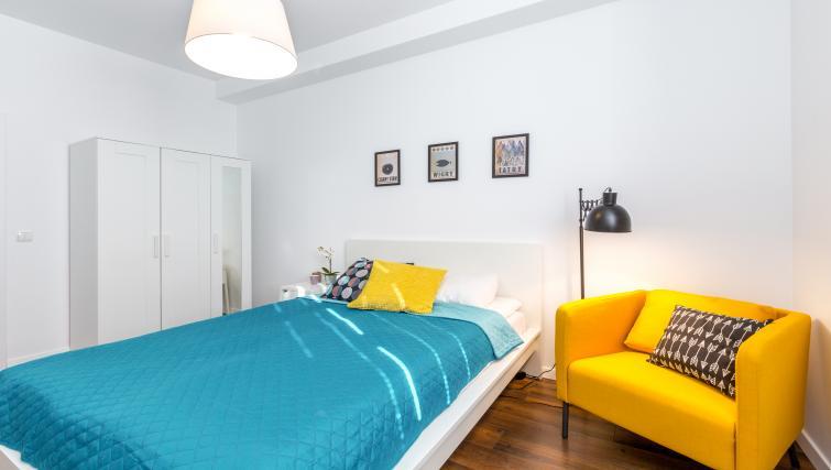 Bright spacious bedroom at Ariańska Residence - Citybase Apartments