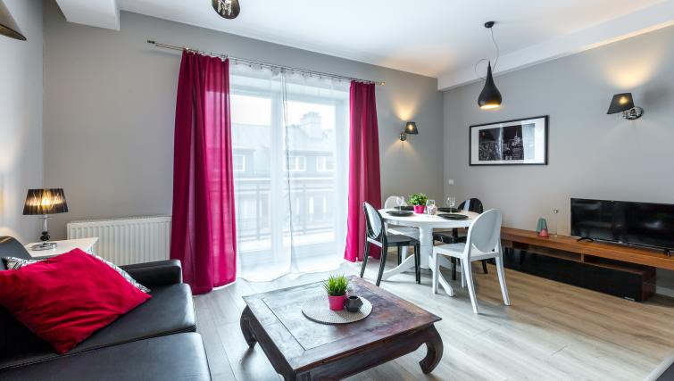 Bright living area at Ariańska Residence - Citybase Apartments