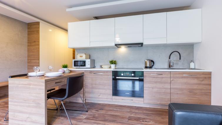 Kitchen at Ariańska Residence - Citybase Apartments