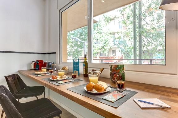 Dining area at Camp Nou Galileu Apartment - Citybase Apartments