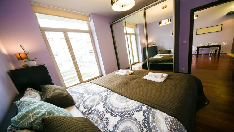 Bright bedroom atLobzowska Apartments - Citybase Apartments