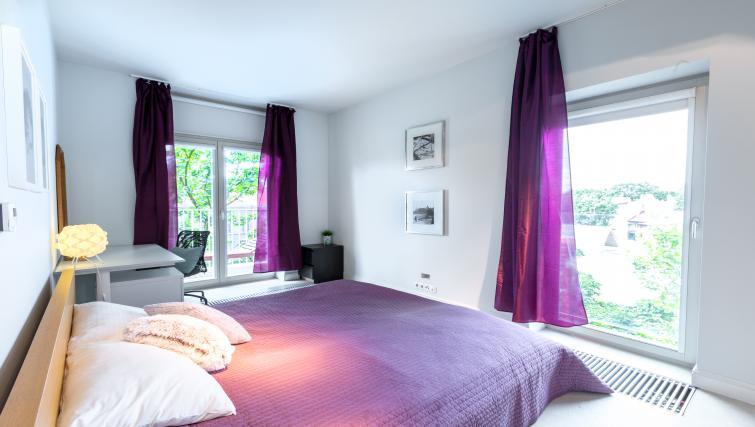 Stylish bedroom at Lobzowska Apartments - Citybase Apartments